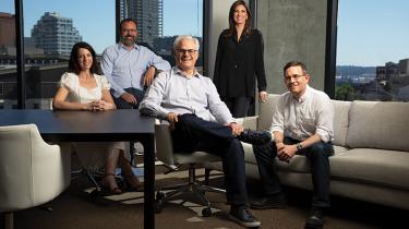 BUILDING BRIDGES. Highspot CEO and co-founder Robert Wahbe, seated at center, with, from left, Jennifer Palecki; David Wortendyke, co-founder;  Haley Katsman; and Oliver Sharp, co-founder.
